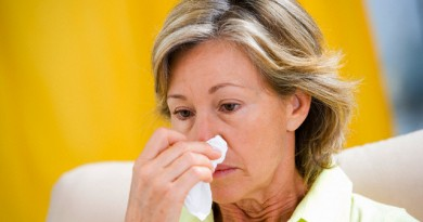 18 Dec 2006 --- Woman With Flu Blowing Nose --- Image by © IMANE/BSIP/Corbis
