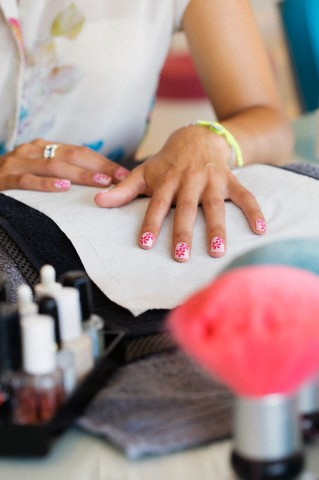 Close up of flower design on woman's fingernails in nail salon